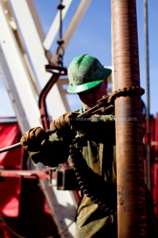 Guy Cummings works to assemble a 90-foot section of pipe on the drilling floor of Robinson Drilling rig #4 on Wednesday, Feb. 17, 2016, in Midland County. James Durbin/Reporter-Telegram