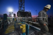 Geoffrey Spencer walks on top of a fluid tank while checking the viscosity of mud used in the drilling process, April 11, 2018, on Trinidad Rig 433 operated by Fasken Oil and Ranch north of Midland, Texas. CREDIT: James Durbin / TheOilfieldPhotographer.com MIDLANDOIL