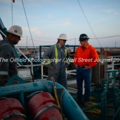 From left, Geoffrey Spencer with Trinidad Drilling, Nick McCoy with Fasken Oil and Ranch, and KC Caulder with Octane Energy, work onboard Trinidad Rig 433 operated by Fasken Oil and Ranch, April 11, 2018, north of Midland, Texas. CREDIT: James Durbin / TheOilfieldPhotographer.com MIDLANDOIL