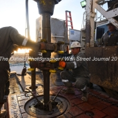 Trinidad Drilling floor hands from left, Ediee Gonzalez and Albert Amador, Jr., connect a new joint of pipe during a drilling operation on Trinidad Rig 433 operated by Fasken Oil and Ranch, April 11, 2018, north of Midland, Texas. CREDIT: James Durbin / TheOilfieldPhotographer.com MIDLANDOIL