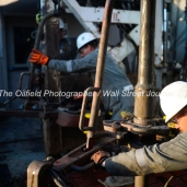 Trinidad Drilling floor hands Ediee Gonzalez, foreground, and Albert Amador, Jr., background, work to connect a new joint of pipe during a drilling operation on Trinidad Rig 433 operated by Fasken Oil and Ranch, April 11, 2018, north of Midland, Texas. CREDIT: James Durbin / TheOilfieldPhotographer.com MIDLANDOIL