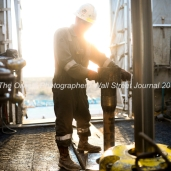 Trinidad Drilling floor hand Ediee Gonzalez prepares a joint of pipe for a connection during a drilling operation on Trinidad Rig 433 operated by Fasken Oil and Ranch, April 11, 2018, north of Midland, Texas. CREDIT: James Durbin / TheOilfieldPhotographer.com MIDLANDOIL