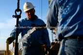 A pulling unit crew installs a pumpjack on a well site, April 11, 2018, north of Midland, Texas. CREDIT: James Durbin / TheOilfieldPhotographer.com MIDLANDOIL
