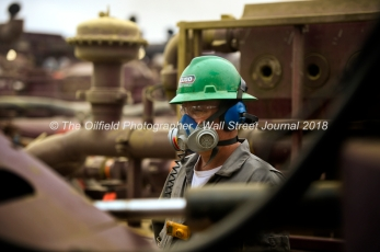 Cudd Energy employees monitor the movement of sand during a fracking operation on a Fasken Oil and Ranch well May 22, 2018, in Midland, Texas. CREDIT: TheOilfieldPhotographer.com