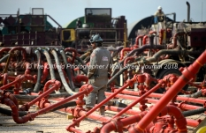 David Cantu, line boss, checks the performance of pumping units during a Cudd Energy fracking operation on a Fasken Oil and Ranch well May 22, 2018, in Midland, Texas. CREDIT: TheOilfieldPhotographer.com