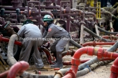 Cudd Energy employees work on pumping units at a Cudd Energy fracking operation on a Fasken Oil and Ranch well May 22, 2018, in Midland, Texas. CREDIT: TheOilfieldPhotographer.com