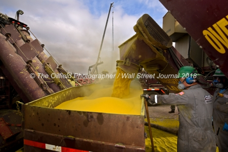 Cudd Energy employees move sand during a fracking operation on a Fasken Oil and Ranch well May 22, 2018, in Midland, Texas. CREDIT: TheOilfieldPhotographer.com