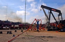 Wellhead and pumping units at a Cudd Energy fracking operation on a Fasken Oil and Ranch well May 22, 2018, in Midland, Texas. CREDIT: TheOilfieldPhotographer.com
