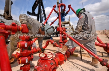 Cudd Energy employees work near a wellhead at a Cudd Energy fracking operation on a Fasken Oil and Ranch well May 22, 2018, in Midland, Texas. CREDIT: TheOilfieldPhotographer.com
