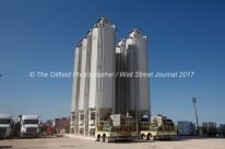 Sand silos used for a coil tube fracturing operation photographed Tuesday, July 18, 2017, in Reagan County, Texas. James Durbin for the Wall Street Journal