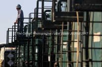 A water transfer employee monitors water tanks used for a coil tube fracturing operation Tuesday, July 18, 2017, in Reagan County, Texas. James Durbin for the Wall Street Journal