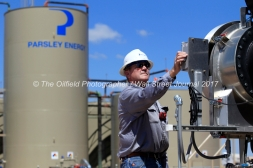 Steve Wilke, lease operator, monitors a Parsley Energy oil well facility Tuesday, July 18, 2017, in Midland County. James Durbin for the Wall Street Journal