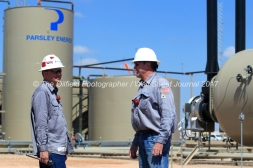 Lease operators Casey Wallace, left, and Steve Wilke, right, monitor a Parsley Energy oil well facility Tuesday, July 18, 2017, in Midland County. James Durbin for the Wall Street Journal