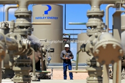 Lee Reyes, flowback operator with Covenant Testing Technologies, monitors production at a Parsley Energy oil well facility Tuesday, July 18, 2017, in Midland County. James Durbin for the Wall Street Journal