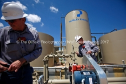 Lease operators Steve Wilke, left, and Casey Wallace, right, monitor a Parsley Energy oil well facility Tuesday, July 18, 2017, in Midland County. James Durbin for the Wall Street Journal