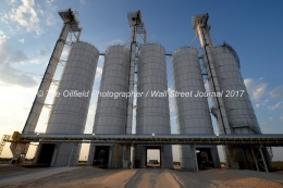 Tractor-trailers are loaded from silos full of sand at the Hi-Crush sand mine, Sept. 7, 2017, north of Kermit, Texas. MANDATORY CREDIT: Hi-Crush / TheOilfieldPhotographer.com