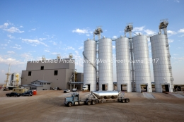 A tractor-trailer pulls away from silos at the Hi-Crush sand mine, Sept. 7, 2017, north of Kermit, Texas. MANDATORY CREDIT: Hi-Crush / TheOilfieldPhotographer.com