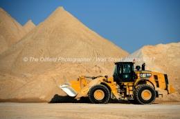 Heavy equipment is used to move sand at the Hi-Crush sand mine, Sept. 7, 2017, north of Kermit, Texas. MANDATORY CREDIT: Hi-Crush / TheOilfieldPhotographer.com