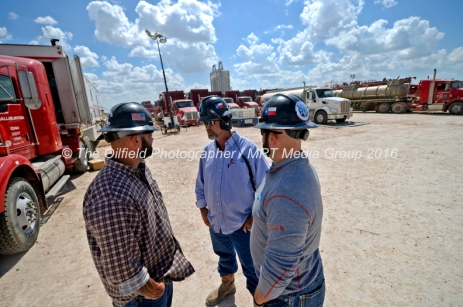 """From left, Octane Energy well-site leaders Justin """"Bull"""" Smith, Todd Greer, and Octane Energy CEO Jared Blong discuss operations on a fracking site managed by Octane Energy on Friday, Sept. 23, 2016 near Stanton. James Durbin/Reporter-Telegram"""