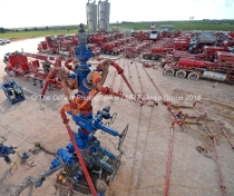 Aerial view of a fracking wellhead powered by a series of Halliburton pumping units at a fracking site managed by Octane Energy on Friday, Sept. 23, 2016 near Stanton. James Durbin/Reporter-Telegram