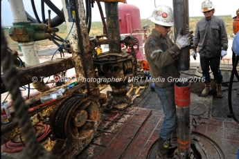 Noe Olvera connects a section of casing on the floor of Trinidad Rig 433 on Wednesday, Nov. 2, 2016, in Midland County. James Durbin/Reporter-Telegram